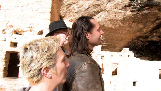 Carl Olafsen with Allie Anderson and Tom Horn at the entrance to an Anasazi ruins.